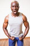 Muscular man shouting while flexing muscles