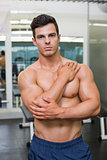 Muscular man posing in gym