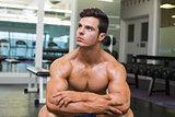 Muscular man looking away in gym
