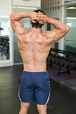 Rear view of a bodybuilder in gym
