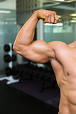 Close-up of muscular man flexing muscles
