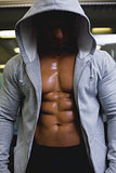 Muscular young man in hood jacket