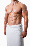 Shirtless muscular man in white towel