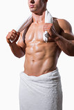 Mid section of a shirtless muscular man in white towel