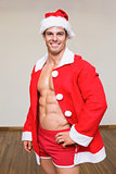 Macho man in santa costume at the gym