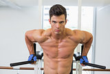 Muscular man doing crossfit fitness workout in gym