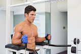 Determined muscular man doing crossfit fitness workout in gym