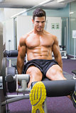Muscular man doing a leg workout at the gym