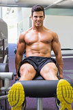 Muscular man doing a leg workout at gym