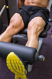 Mid section of muscular man doing a leg workout