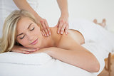 Pretty blonde enjoying a massage