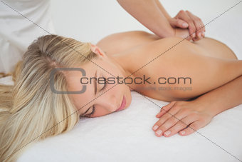 Beautiful blonde enjoying a massage