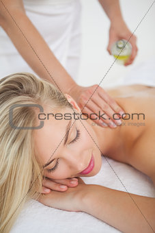 Beautiful blonde enjoying a back massage