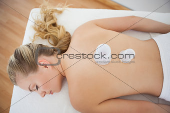 Beautiful blonde with vacuum cups on her back