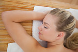 Beautiful blonde relaxing on massage table