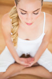 Peaceful blonde sitting in lotus pose