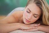 Peaceful blonde lying on towel
