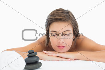 Close up of a beautiful young woman on massage table