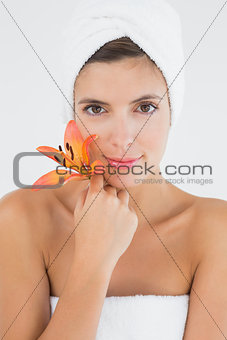 Close up of a beautiful young woman holding flower