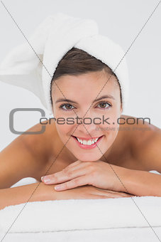 Close up portrait of a beautiful woman on massage table