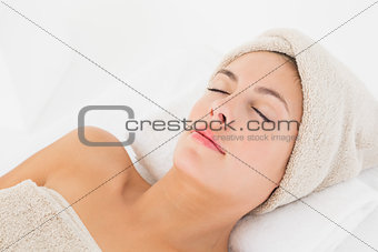 Beautiful young woman on massage table