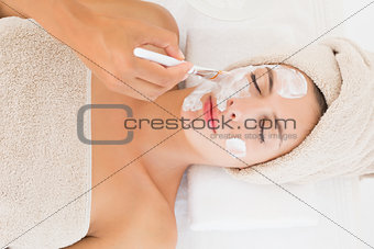 Attractive young woman receiving treatment at spa center