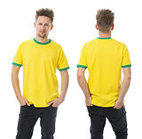Man posing with blank yellow and green shirt