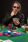 Smoking poker player wearing sunglasses