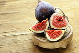 fresh ripe purple figs on wooden board
