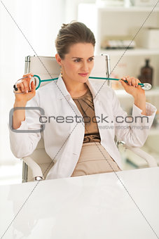 Portrait of relaxed doctor woman in office