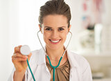 Smiling doctor woman using stethoscope