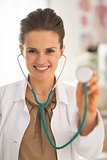 Portrait of doctor woman using stethoscope