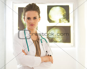 Portrait of doctor woman in front of lightbox