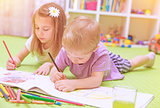 Happy baby boy & girl enjoying homework