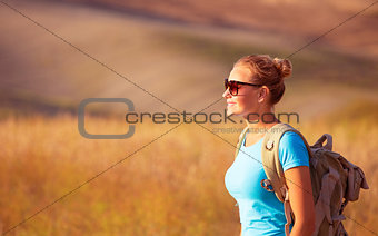 Beautiful traveler girl on field