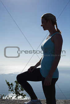 Fit woman standing looking out to sea