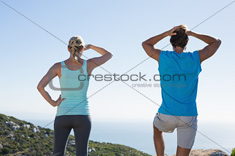 Fit couple standing looking out to sea