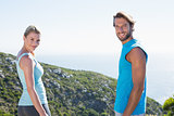 Fit couple standing smiling at camera