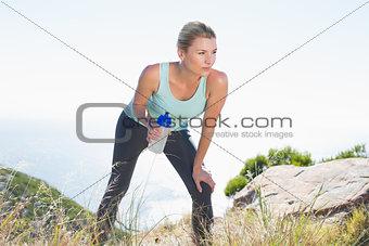 Fit blonde taking a break at summit
