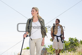 Attractvie hiking couple walking on mountain trail