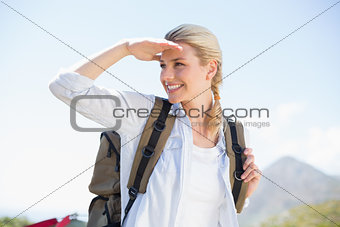 Attractive hiking blonde looking around