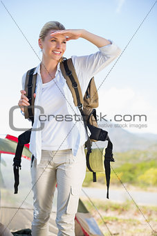 Attractive hiking blonde looking around her