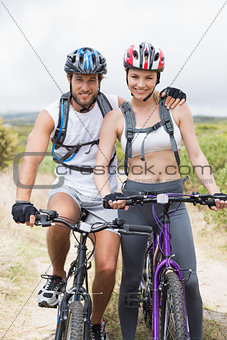 Fit couple cycling on mountain trail
