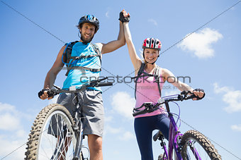 Fit cyclist couple happy to have reached the summit