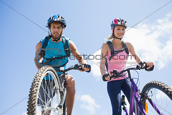 Fit cyclist couple about to cycle down