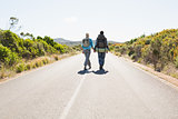 Attractive couple walking on the road holding hands