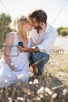 Attractive man proposing to his girlfriend in the country