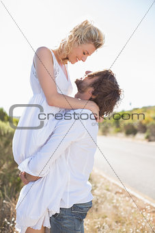 Attractive man lifting up his girlfriend