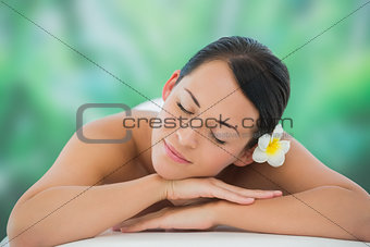 Beautiful brunette relaxing on massage table