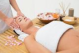 Peaceful brunette enjoying a head massage